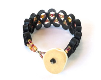 recycled inner tube bracelet with glass beads and a porcelain closure, handmade