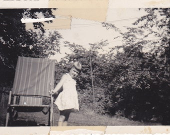 Vintage Black & White Snapshot Photograph: Girl Chair Outdoors Tree 1950 1950's 18A