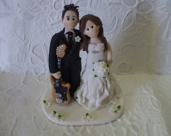 custom bride and groom with guitar wedding cake topper