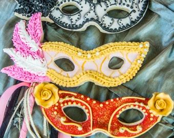 Six masquerade masks