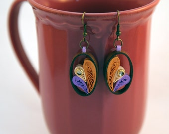 Oval paper earrings with ecologycal varnish. Handcrafts.