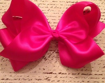 Large pink satin bow clip