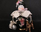China assemblage doll.  Ooak with porcelain head, Victorian hat pin holder body and adorned with lace, jewelry and accompanied by a dog.