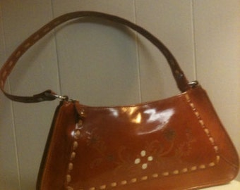 Vintage leather handbag/purse, made in India.