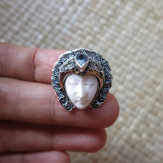 Silver Ring Moon Face Cow Bone Carving with Gold Plated Edging and Blue Topaz