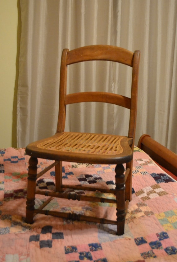 Vintage wood side chair with cane seat ladder back by
