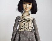 Doll in a gray dress