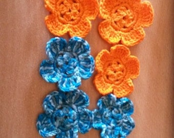 Blue and orange crocheted flowers