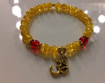 "Yellow & Red Yoga Bracelet - 7"" gold Ohm charm"