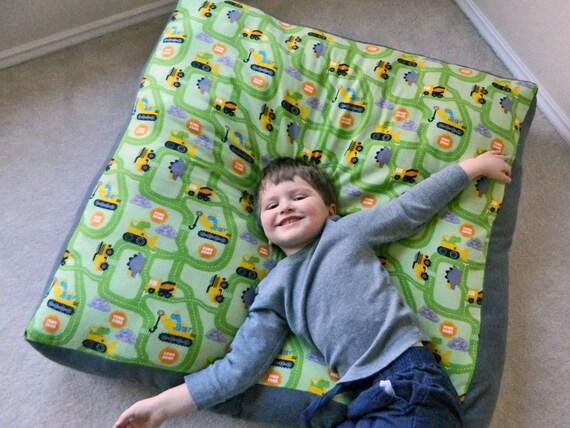 kids floor pillow dinosaur construction print oversized. Black Bedroom Furniture Sets. Home Design Ideas