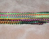Inkle Woven Strap, Red Heart 'Blacklight' yarn for the warp, black acrylic yarn for the weft