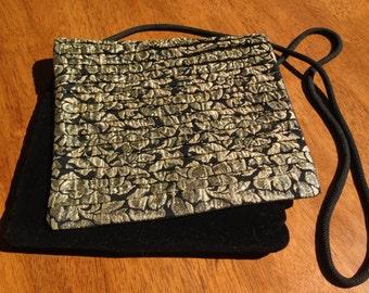 Black velveteen and black and gold metallic fabric handbag