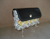 Wallet  with faux leather flap, made of hand woven recycled fashion magazine paper