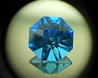 Blue Topaz | 8.70ct | Precision Cut | Gorgeous Hexagonal Stone. Mirror type flash goes all around the stone. Uncommon cutting design.