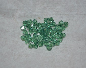 24 - 4mm Genuine Swarovski Crystal Beads - Erinite