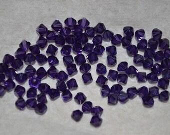 24 - 5mm Genuine Swarovski Crystal Bicone Beads - Purple Velvet