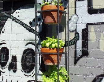 Vertical garden. A steel plant stand for both indoor and outdoor use.