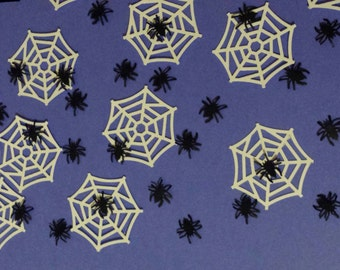 100 spiders and webs- Hand punched confetti- halloween