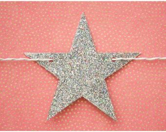 Silver rainbow iridescent glitter stars garland strung on metallic silver & white colored hemp twine READY TO SHIP