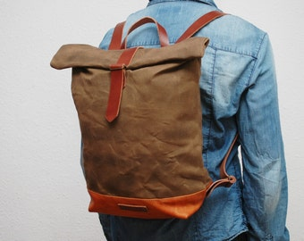 waxed Canvas rucksack/backpack, brown color, hand waxed , with handles, leather base and  closures