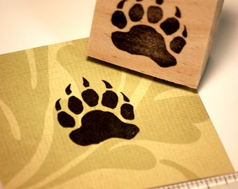 Hand carved rubber stamp - bear paw print.