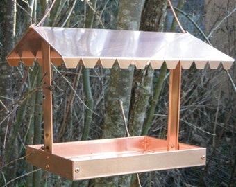 Solid copper bird feeder.