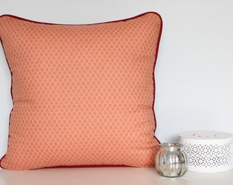 Peach patterned cushion cover with red piping and charcoal back - 45cm x 45cm