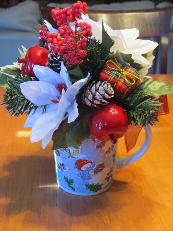 Flower arrangement snowman coffee cup