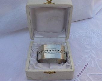 former silver ring in her casket