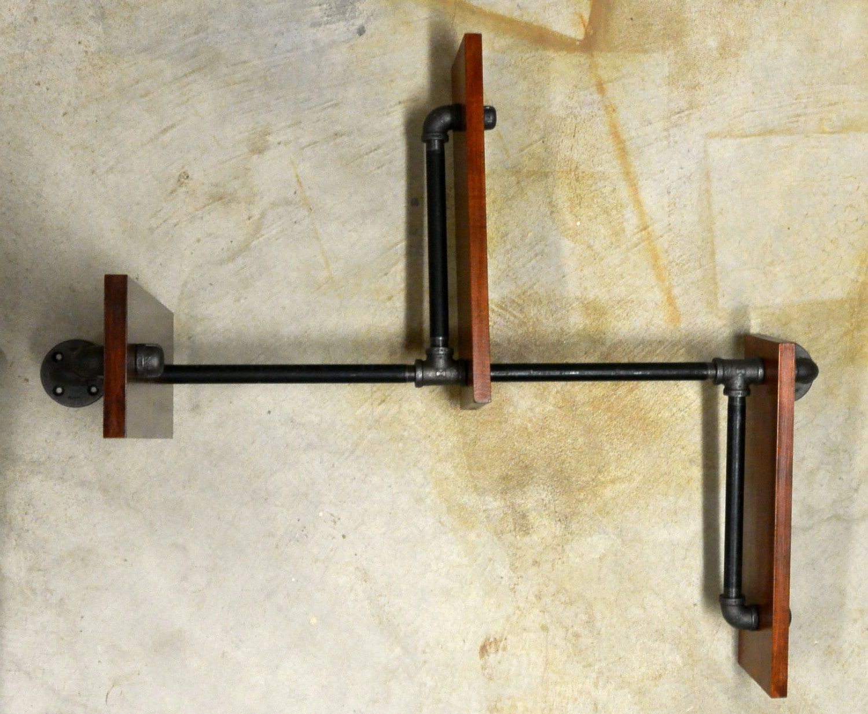 Adjustable plumbing pipe shelving unit