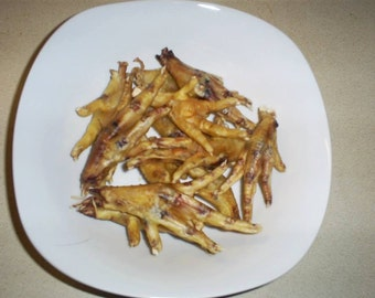 Dogs love them!  All natural and wonderfully delicious.  Maggienificent dehydrated chicken feet.  Sold by the dozen.