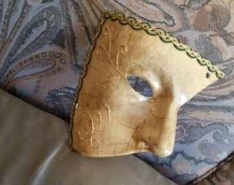 Venetian Opera Verde.Crema mask with filigree. Bordered with gold trimmings and green. Ideal for Carnival or gift.