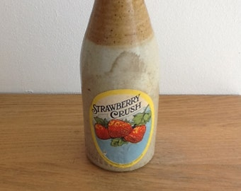 Very old stone bottle R Bowes and Son Manchester with vintage strawberry crush label attached