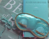 delicate tiffany blue satin sleep mask with a organza bag inspired by Audrey Hepburn's Breakfast at Tiffany's
