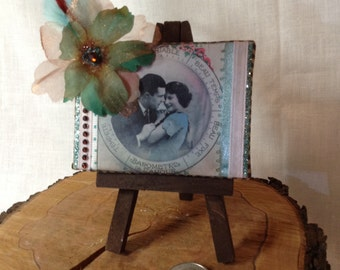 Mini collage art on canvas, with stand