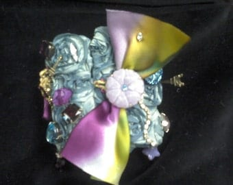 One-of-a-kind cuff bracelet hand-crafted from vintage millinery, jewelry findings, and silk ombre ribbons