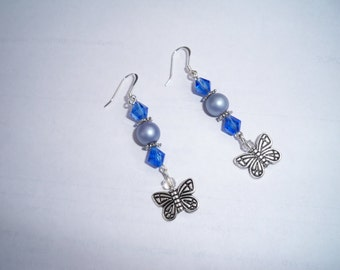 Pair of sterling silver fishhook earrings with blue crystals, gray beads, and butterfly charm