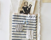 Textile art, mini art quilt, hand-stitched, photo in pouch