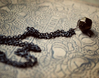 Casting Bones. Antique Hand Cut Bronze Glass Bauble and Antiqued Brass Necklace.