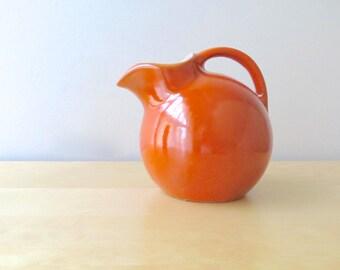 red orange rumrill redwing pottery tilt ball pitcher 547