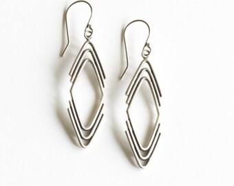 "Geometric dangle silver earrings in an arrowhead shape handmade of individually formed pieces of silver wire - ""Arrowhead Earrings"""