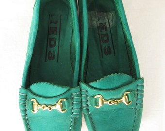 Vintage green suede loafers with gold bits