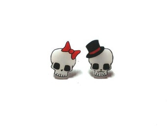 Tiny lady and gentleman skull earrings
