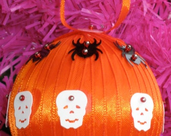 Orange Halloween Ball Ornament with Spiders, Skulls, and Black Cats