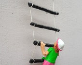 Girl Climbing Ladder Paper Sculpture