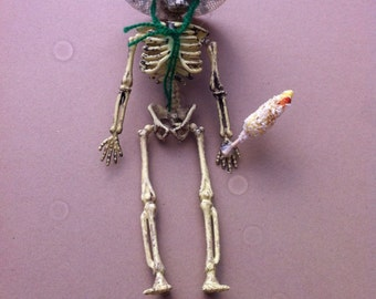 day of the dead skeleton with an elote (corn)
