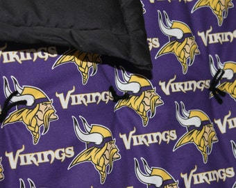 Minnesota Vikings stadium quilt, can also be used on a twin bed or picnic blanket.
