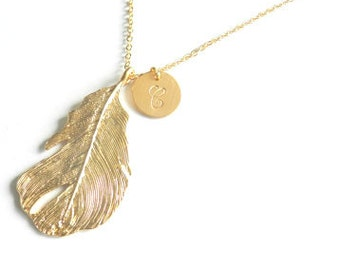 Gold Feather and handstamped charm necklace.