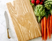 Customized Wooden Cutting Board. Carved initials on tree, personalized anniversary present, engagement gift.