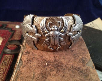 Art Deco Egyptian cuff.  A brilliant combination of an ancient design even Cleopatra would have embraced.